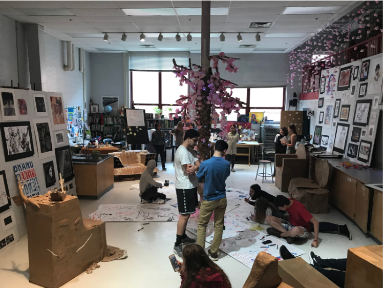 McLean students enjoy the various offerings of the studio art room. Some sit on the large cardboard chairs, others draw on the communal drawing areas and still more look at the art around.