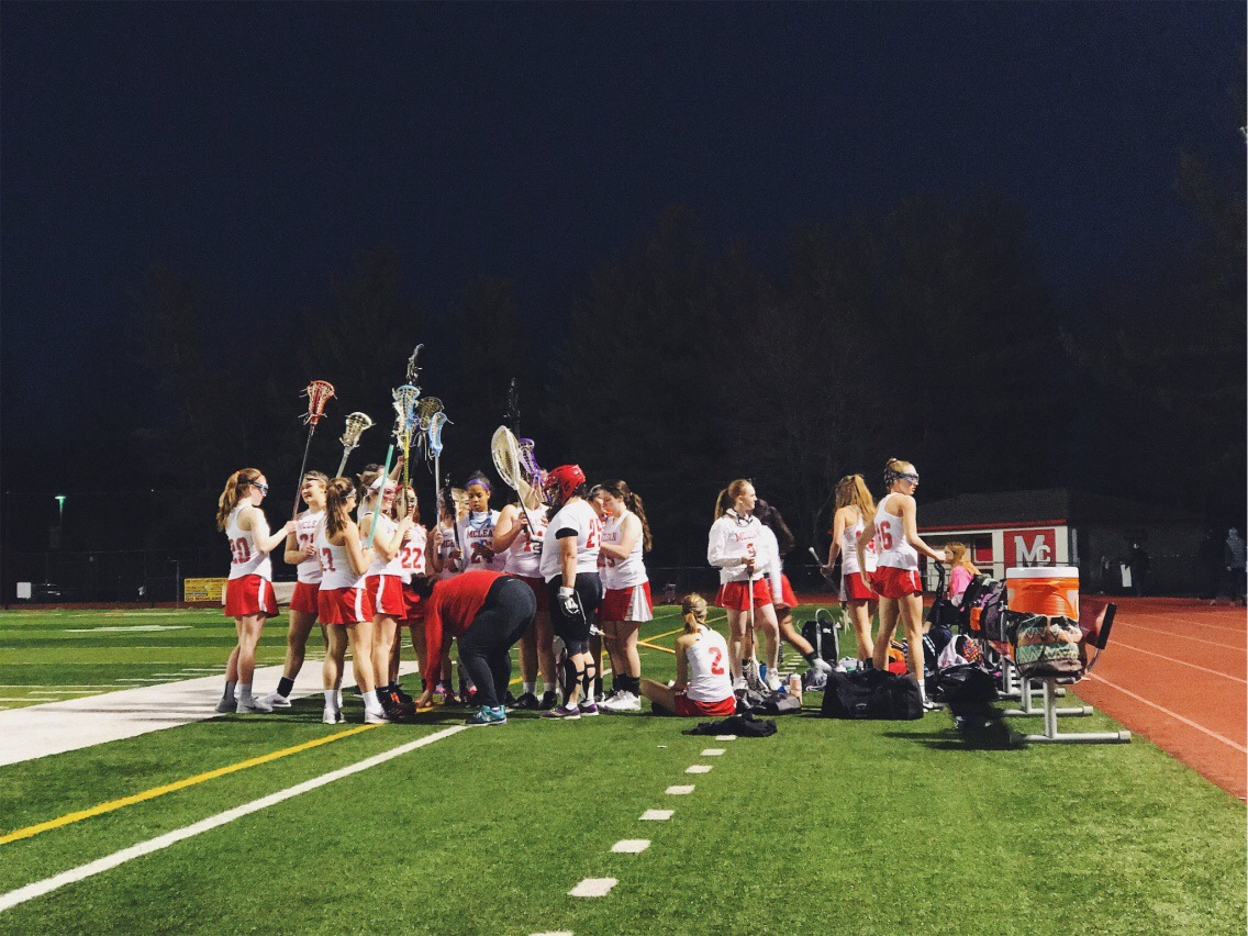 Players meet during a home game against Marshall on April 14.