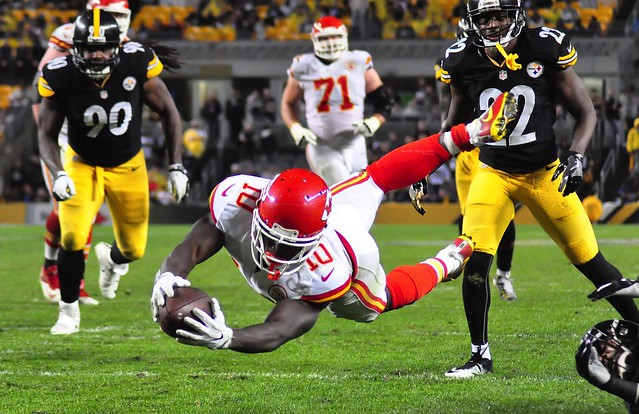 Tyreek Hill dives toward the goal line in a game against the Pittsburgh Steelers.
