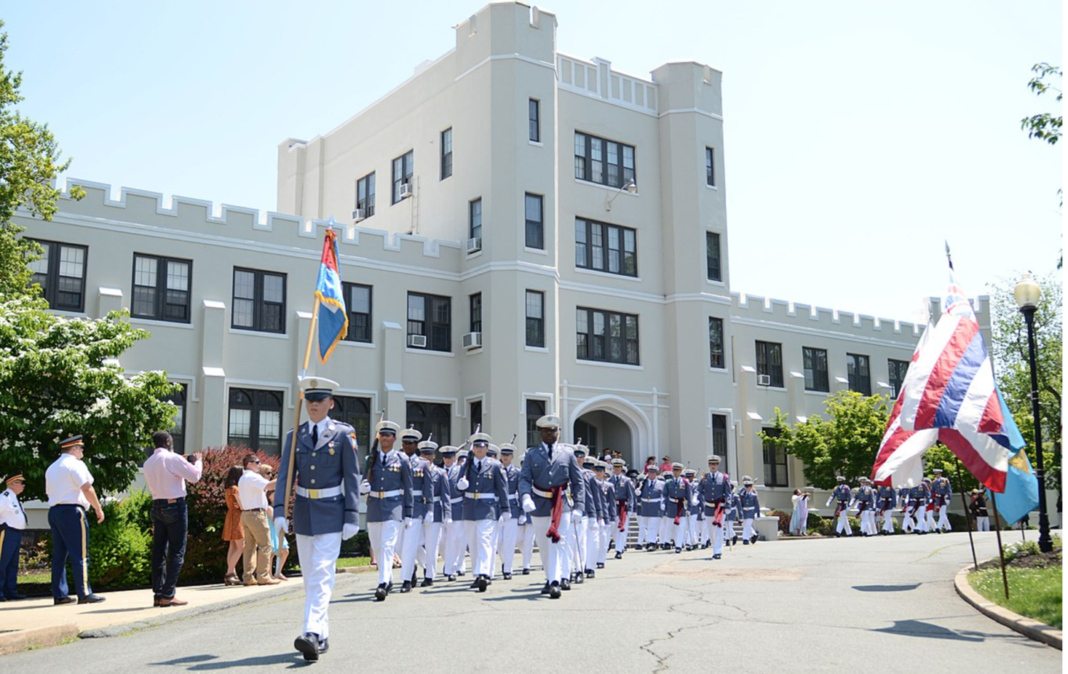 Cadets at Fork Union Military Academy march in front of the white building. They are marching for the Mother's Day Parade in May 2018. (Photo obtained under creative commons license)