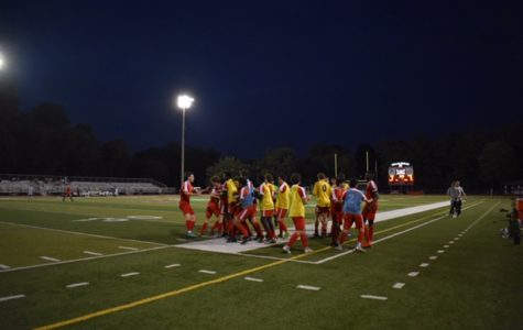 The Boys Varsity Soccer team celebrates on the field after Kyle Goldstein scores the winning goal.