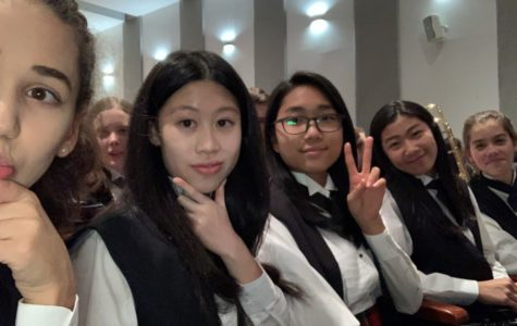 Freshman Nicole Chan (second from the right) is seen here posing for a picture with her friends. This was during a band concert while they were waiting for their performance.