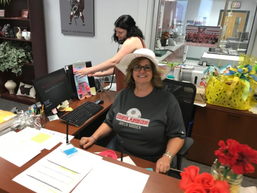 Administrative assitant Lidia Martain sits at her ask waiting for anyone who may need her help. She deals with things such as checking people in, showing people where to go, answering the phone, and coordinating to fix any problems with the school.