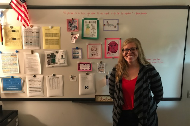 New+freshman+and+sophomore+school+counselor%2C+Jenna+Jablonski%2C+smiles+in+front+of+her+Inspiration+Board.+She+is+looking+forward+to+a+great+school+year+at+MHS.