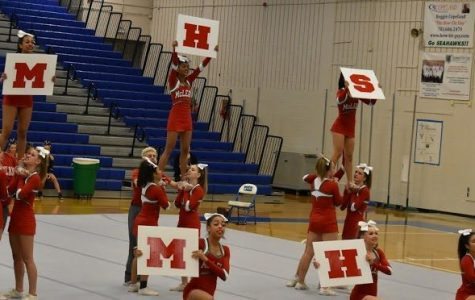 The cheer team represents McLean at their district competition. Photo by Isaac Lamoreaux.