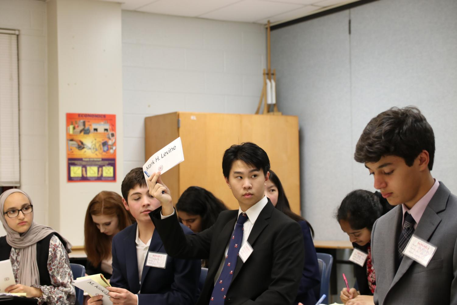 DEBATING DELEGATES - A delegate opts to speak in a conference room during McMUNC on Saturday, Oct. 26. Public speaking and debating is a crucial skill to have in MUN.