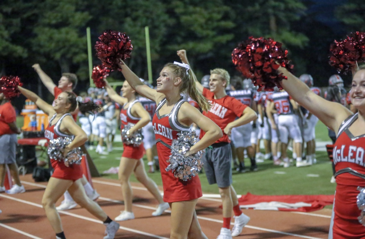 HOCO HYPE - McLean cheer team gets the crowed pumped for the Homecoming football game.