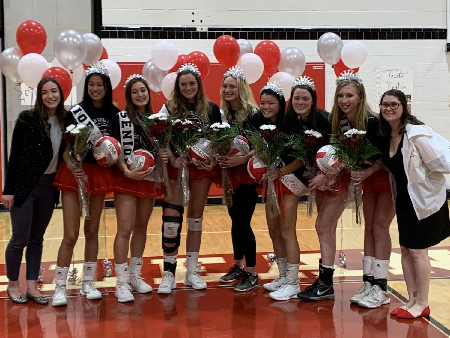 The seniors line up with the varsity coaches after entering the gym with their families and receiving their flowers. (Photo by: Emily Friedman)