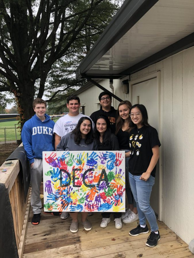 DEDICATED DECA - McLean DECA members join together for a picture as they celebrate the new leadership team being made.