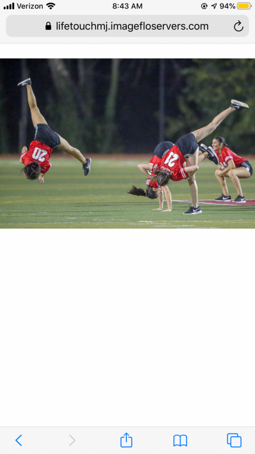DYNAMIC DUO The McLean varsity dance team preforms their new skills and talents at the homecoming football game during half time. We usually come up with the dances for the football and basketball games, senior Mason Glembocki said.
