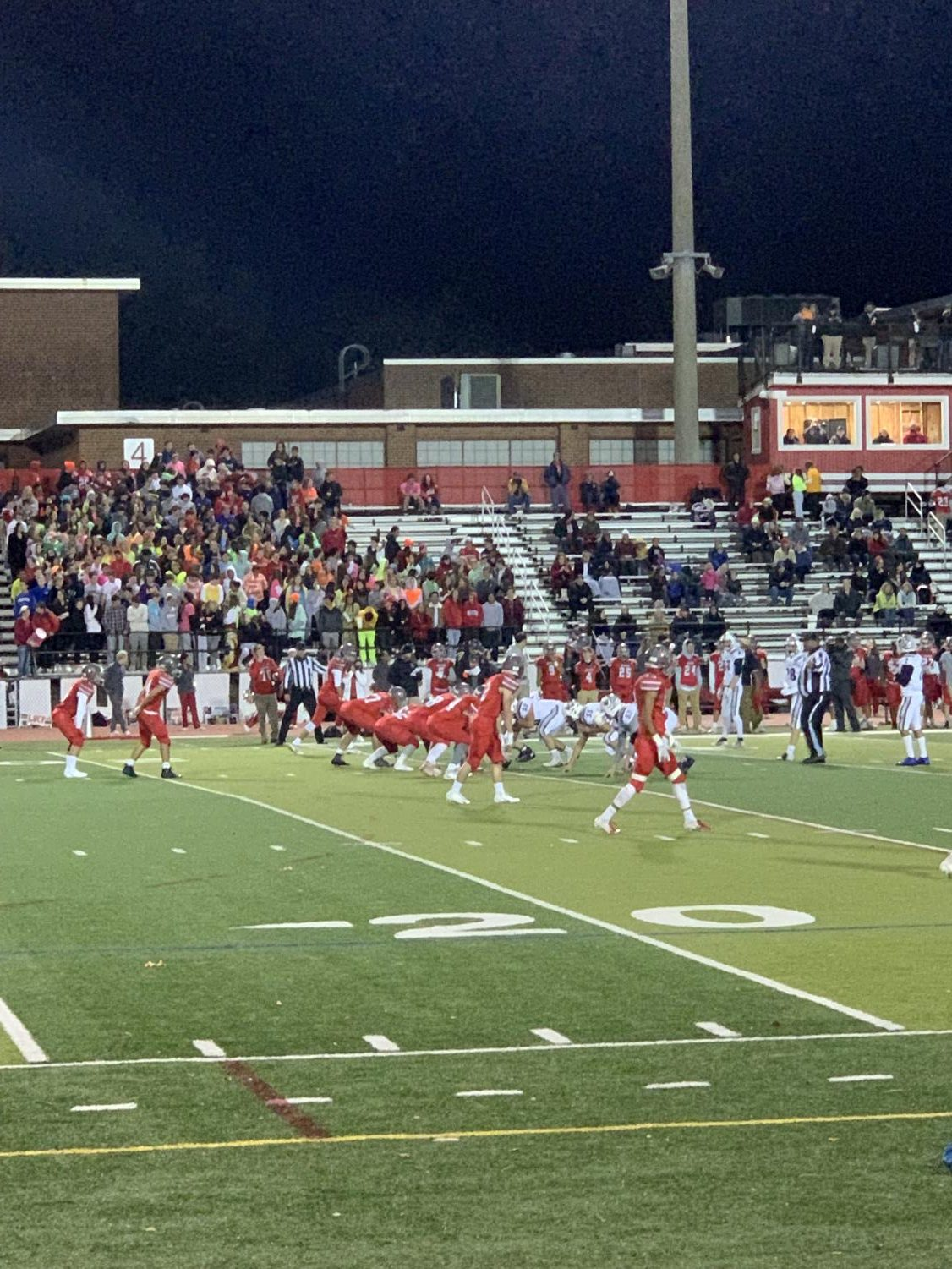 McLean varsity football team is on offense against Washington Liberty. It is the first quarter and the game is getting exciting.