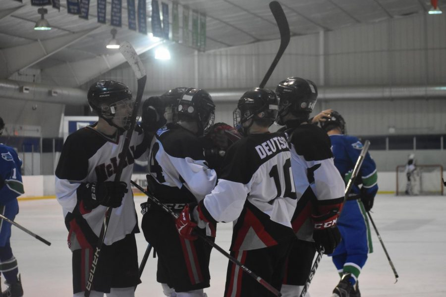 McLean+hockey+celebrating+after+the+first+goal+scored+by+senior+Matthew+Regan.
