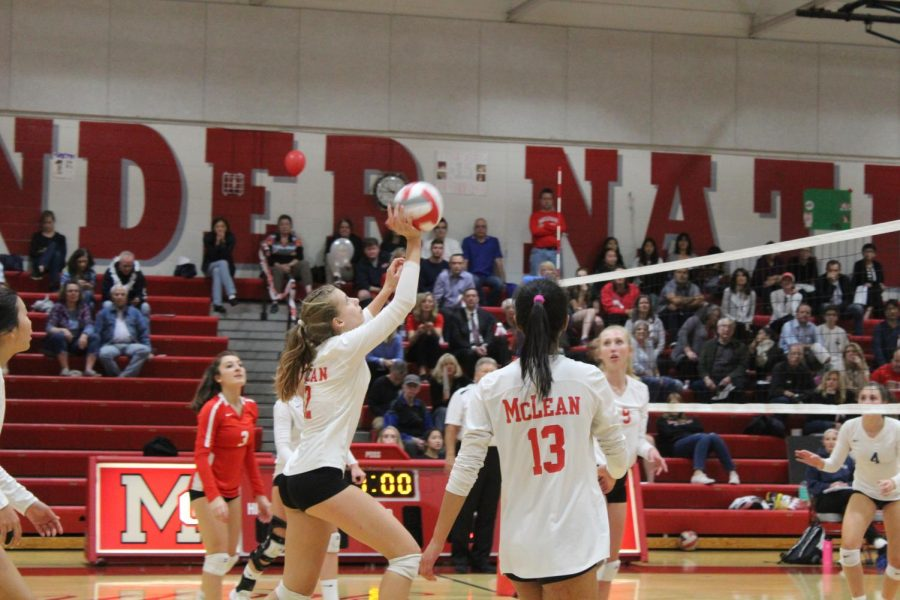 Nicole Mallus sets the ball up during McLean's volleyball game against W-L. It was McLean's Senior Night as well.