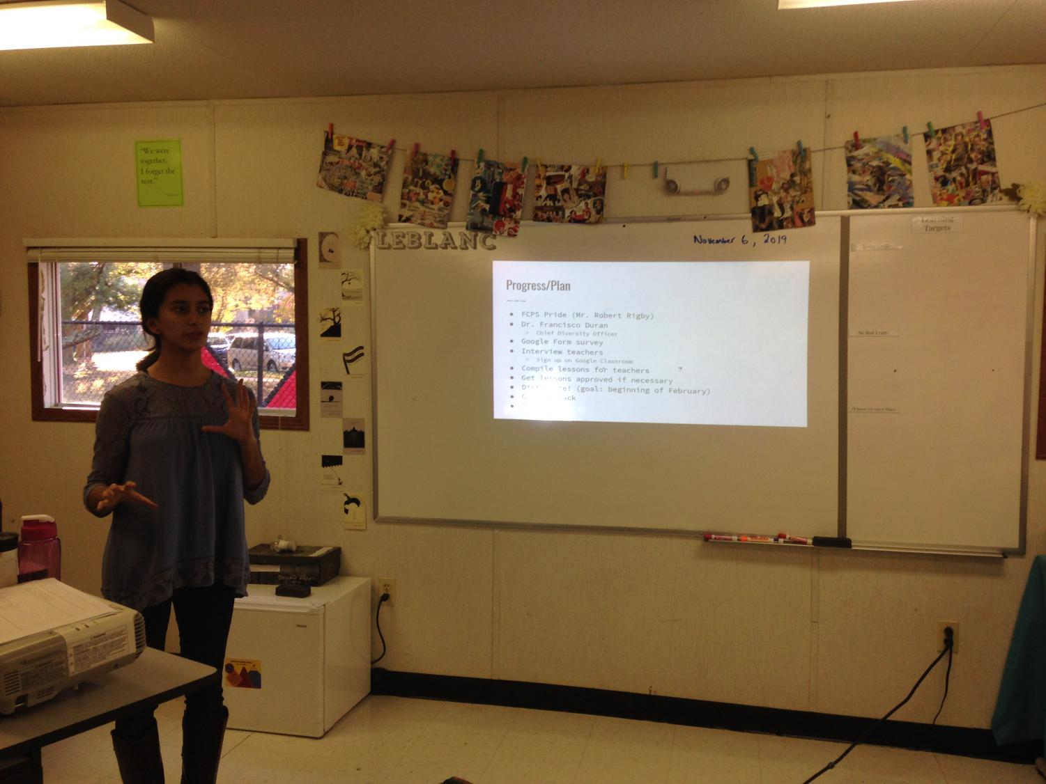 Incorporating inclusion-Junior Sanjna Kaul is shown explaining the project. She describes what this change would mean, what classes it would effect, and the steps of the process (Photo taken by Cordelia Lawton).
