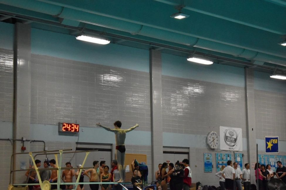 The divers perform their dives at Spring Hill on Friday, Dec. 6. The Highlanders ended up losing to the Saxons.