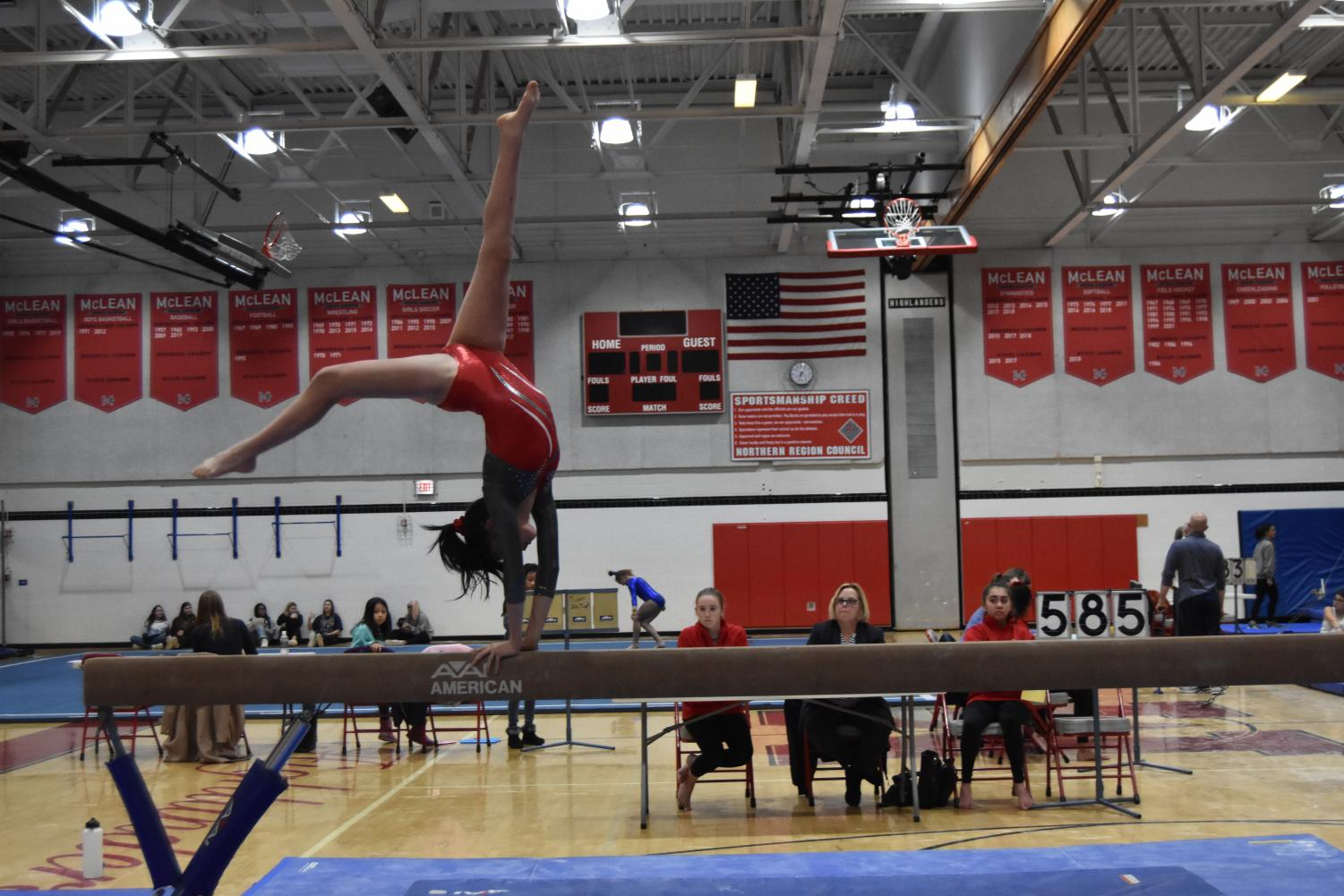TUMBLING TARA—Senior team captain Tara Stewart competes on the balance beam at the home meet on Dec. 2. She has been practicing gymnastics for 14 years.