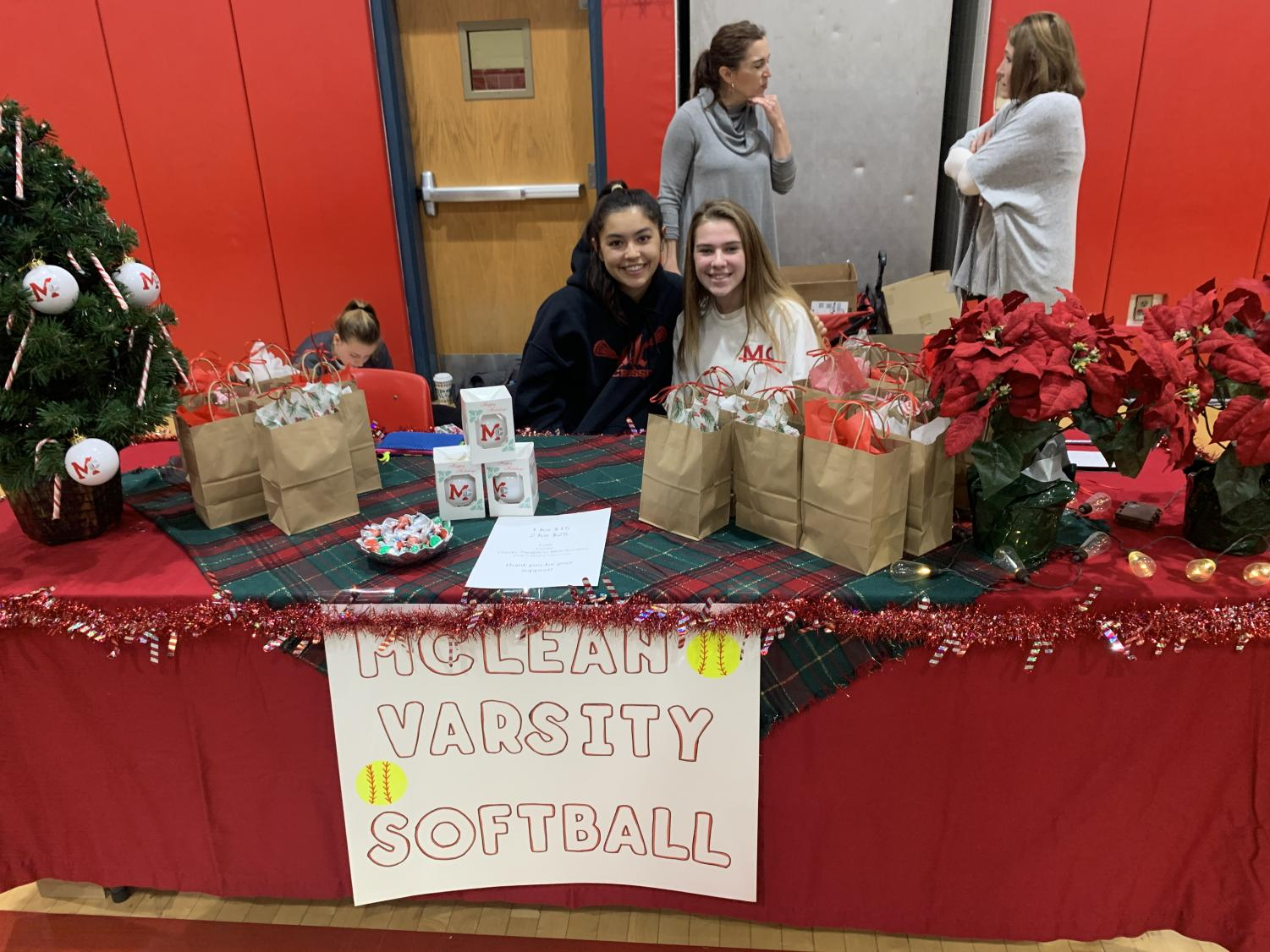 HOLIDAY HOME RUN —Girls varsity softball has spirit even in the off season. Along with selling beautiful gifts, they decorated their booths in celebration of the Christmas spirit.