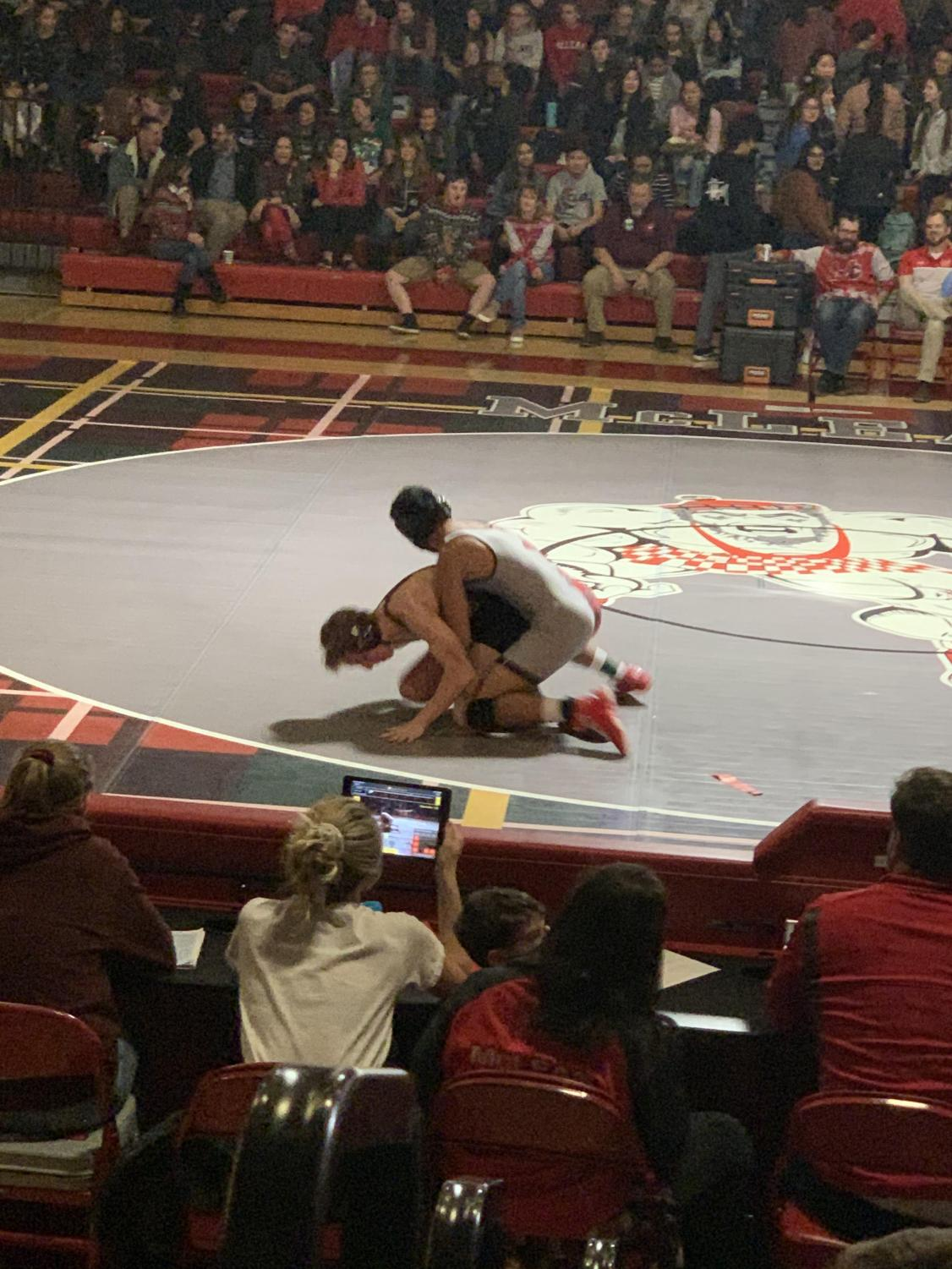 A McLean wrestler secures two points for a take down. McLean was able to score off their take downs throughout the night.
