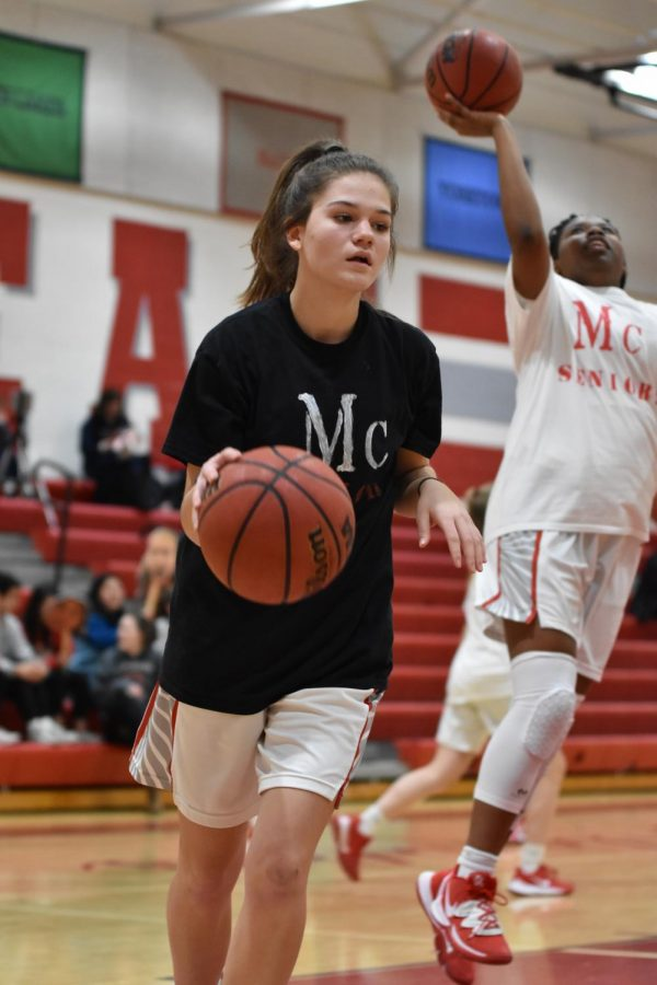 WINNING WARM-UP—Senior Elly Glenn warms up for her game against Washington Liberty. McLean won the game with a score of 64-50.