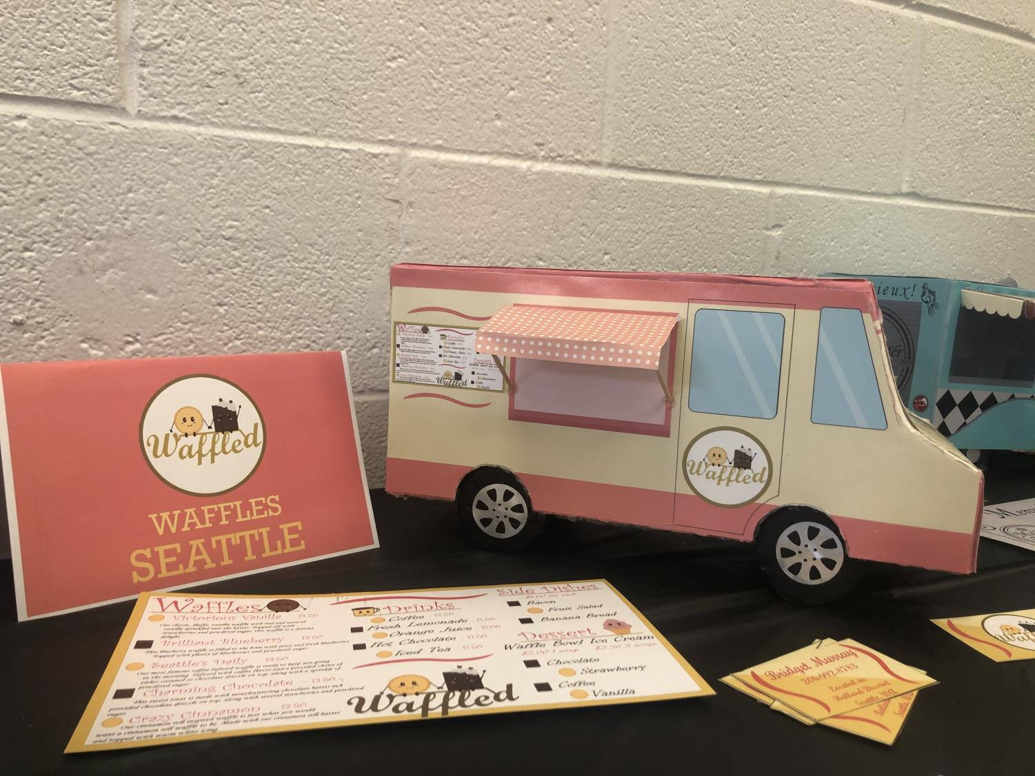Students created and designed their own Food Truck exterior and menu. This food truck sold waffles in Seattle.
