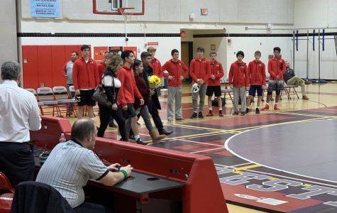 Varsity wrestling steals a win on Senior Night