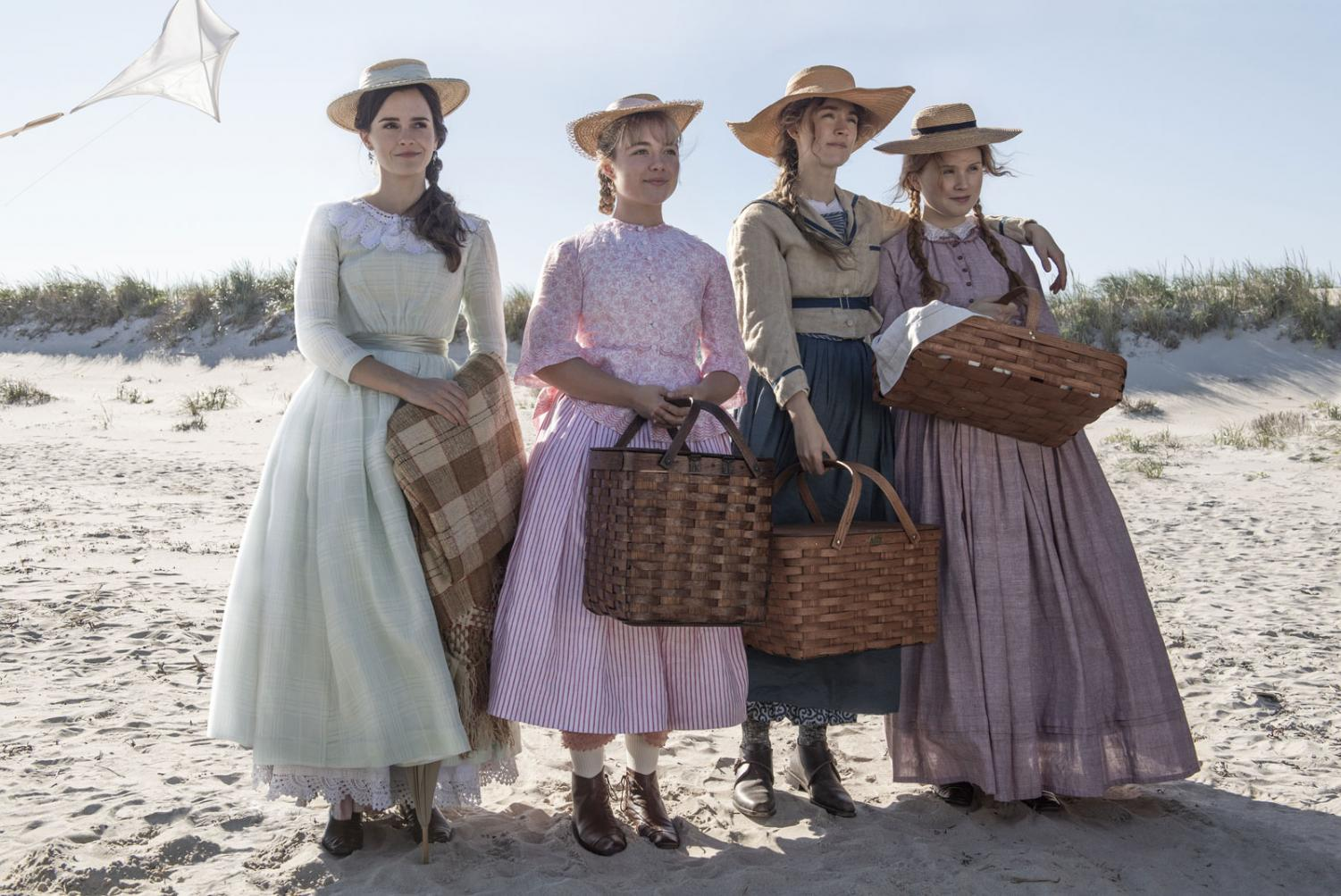 The March sisters stand together on a beach. Actors Emma Watson, Florence Pugh, Saoirse Ronan, and Eliza Scanlen are pictured. Photo obtained via Sony Pictures and Columbia Picture.