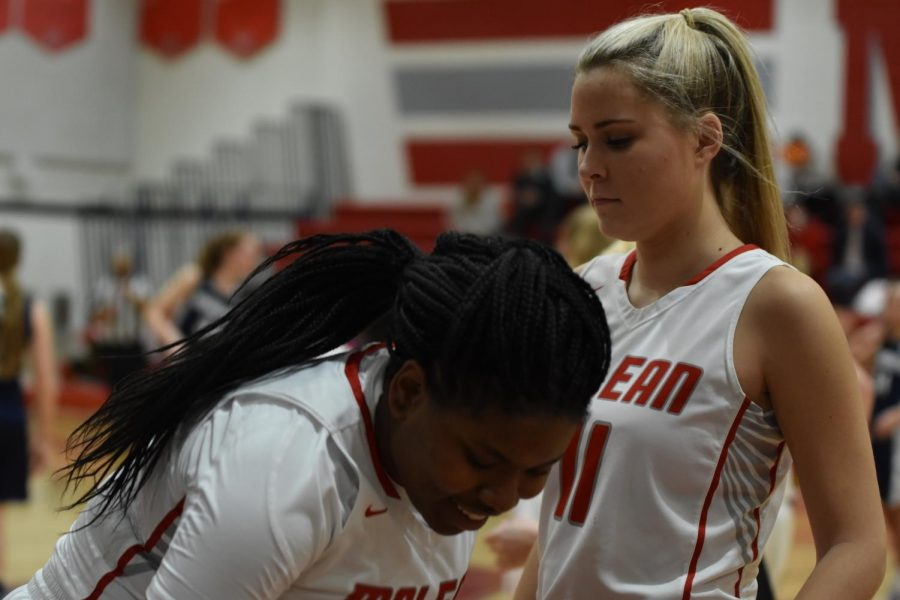 Juniors Kendall Jones and Sophie Smith prepare for their game against Herndon. They went on to win 58-44.