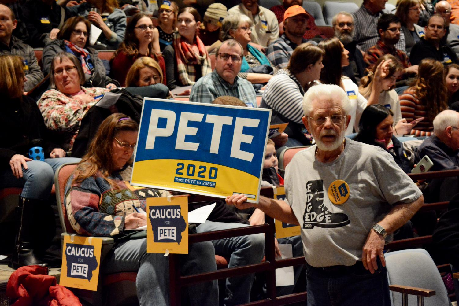 Supporters of Democratic candidate Pete Buttigieg congregate in support at the Iowa Caucus on Monday. Buttigieg went on to win the caucus by a small margin.