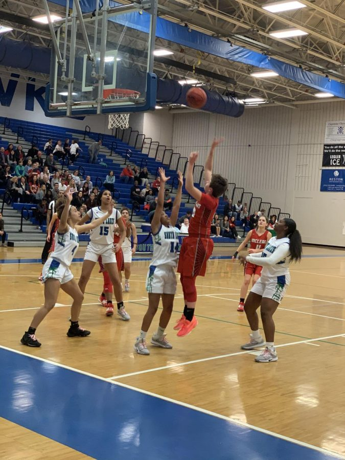Senior guard Elizabeth Dufrane attempts the tough floater in close game against South Lakes.