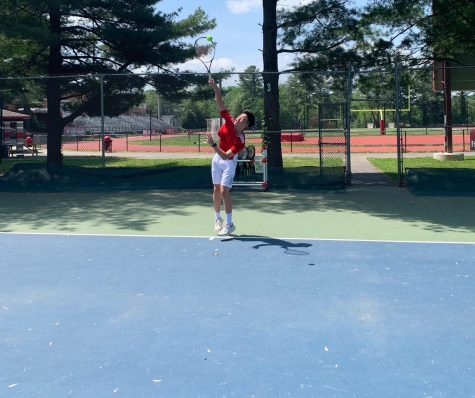 Tommy Lam serving during spring 2018-2019 season.