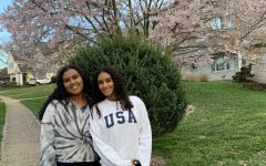 Heran and her sister on a walk around their neighborhood. They stopped to take some pictures next to a pretty tree they found.