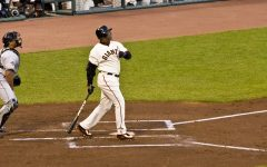 Barry Bonds swings, delivering one into the seats. Although he hit a record setting 762 home runs, his steroid use strips him of this title. (Photo obtained under fair use via Creative Commons license).