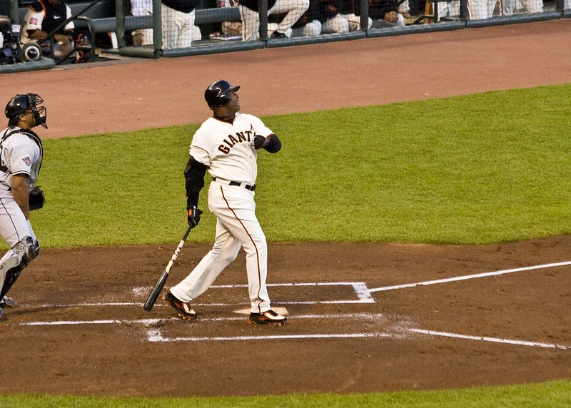 Barry+Bonds+swings%2C+delivering+one+into+the+seats.+Although+he+hit+a+record+setting+762+home+runs%2C+his+steroid+use+strips+him+of+this+title.+%28Photo+obtained+under+fair+use+via+Creative+Commons+license%29.