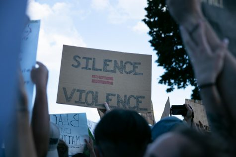 "Protesters have taken up the phrase ""silence is violence,"" arguing silence  encourages the continuation of unjust police brutality."