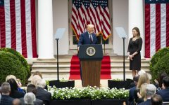 Barrett stands by at Trump introduces her as his nominee for Supreme Court Justice in a Rose Garden White House ceremony. It is still unconfirmed whether this selection will stand with the upcoming election. (Image obtained via The White House on Flickr under a creative commons license.)