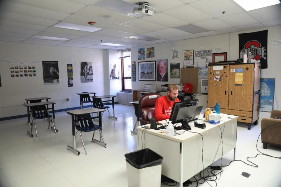 Social studies teacher Joseph Dwyer instructs AP Psychology in an empty classroom at McLean. He chooses to teach at school despite virtual learning.