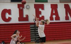 SHARP SHOOTER - During tryouts, senior Sophie Smith finishes the 3 man passing drill with a wide open shot.