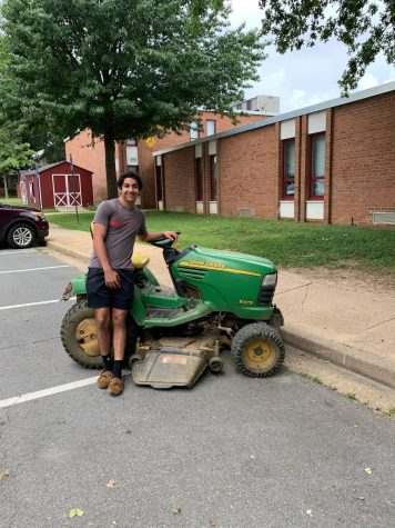 Senior Matthew Zarkani leaning next to the school lawnmower. Zarkani is happy to start his last year in McLean.