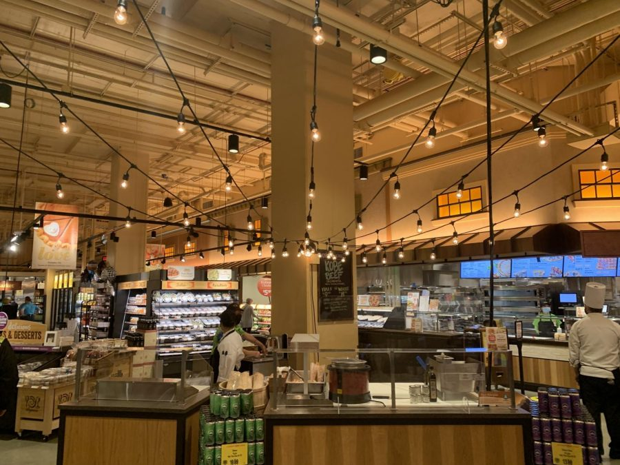 The new Wegmans, located in Tysons, sells a variety of pre-made foods in a warm atmosphere.