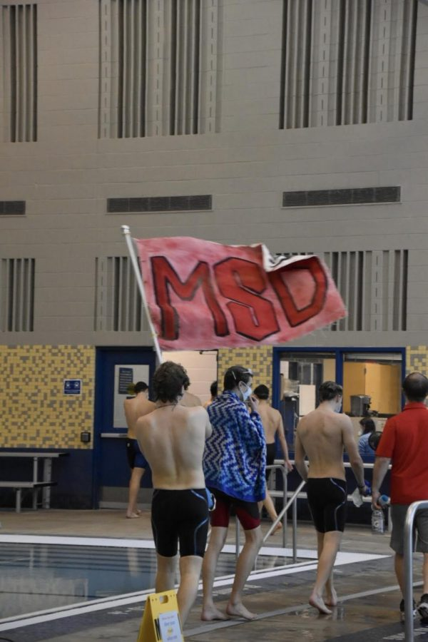 HIGHLANDER+PRIDE+-+Varsity+swimmer%2C+Atticus+Gore%2C+holding+up+the+McLean+Swim+and+Dive+flag+at+the+regional%2Fdistrict+qualifiers+meet.