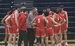 The team stands in a huddle during the game against Marshall in Regionals. McLean came on top with the win. (Photos provided by Zaiba Hasan)