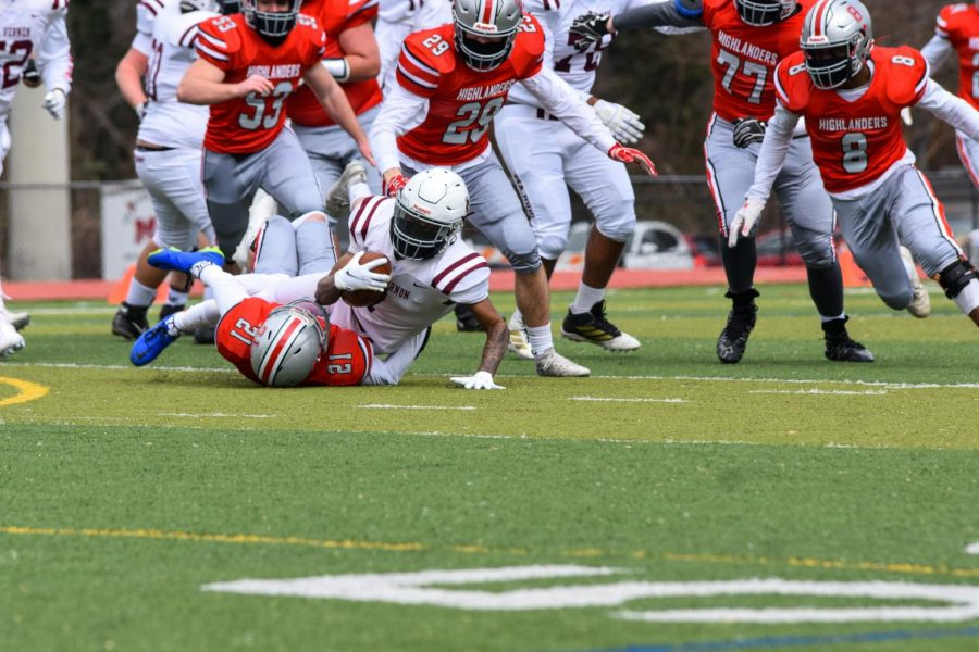 MOB TIES: Swarming Highlander defenders bring down the Majors running back. The McLean defense gave up just 14 points in their two-score win.