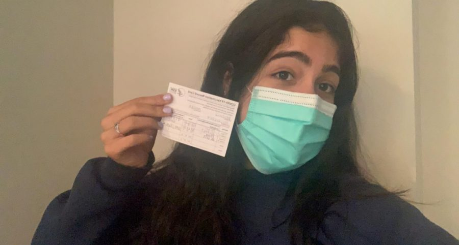 Junior Amelia Badipour snaps a selfie after getting vaccinated.  Badipour received both doses of the Pfizer vaccine in February.
