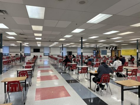 Student sit in the cafeteria during their lunch period. The uniform set up and strict social distancing may allow for better student safety, but minimize valuable social interaction.