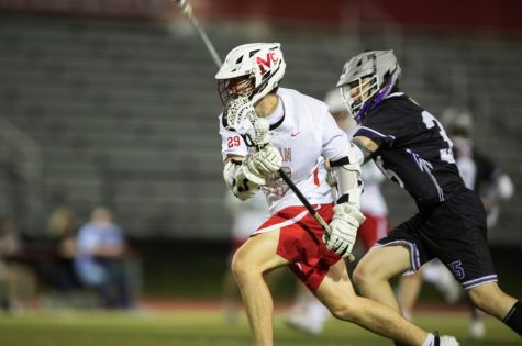 La-Crossing The Field - Senior attacker Alec Butler (#29) cradles the ball past a Chantilly defender on Apr. 29. Butler and the rest of McLean