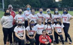 """WORK HARD, PLAY HARD — McLean High School's softball team is committed to wearing masks when necessary during games and practices. """"They've helped [a lot] during practices to keep [players] safe while they're on the field,"""" junior and softball player Nicole Chan said."""