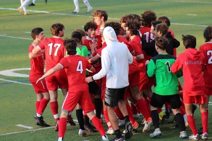 The McLean team celebrates an amazing win over cross town rival Langley High School. Senior player Kobe McCowan scored a hattrick in the match, which concluded with a final score of 5-1. Photo courtesy of McLean Activities.