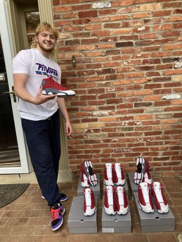 """COOL COLLECTION — Junior Brigham Devore poses with some of his Air Jordan sneaker collection. """"[I] Worked hard to get these, it was a good drop for me,"""" Devore said."""