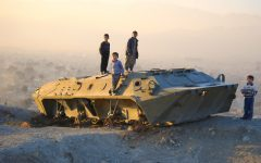 Desert Deployment — Three Afghan children stand atop a military vehicle in Kabul. The decade-long war against terror has affected the lives of many innocent civilians. (Photo obtained via Creative Commons)