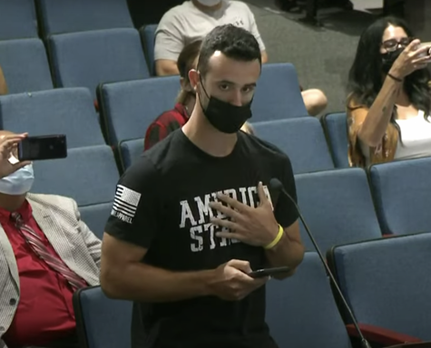 Recent high school graduate Jason Rotondi speaks before the board. He argued against the newly implemented vaccine mandate for high school athletes.